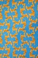 "Трикотаж ""Золотые завитки"" на голубом фоне"